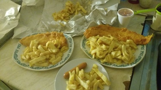 Wellingborough, UK: Nemo's large cod small cod small sausage  and one large portion of chips