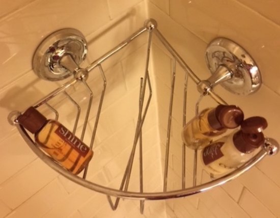 Sheraton Seattle Hotel: This is the broken shower soap tray in our room. It has sharp metal and is actually dangerous
