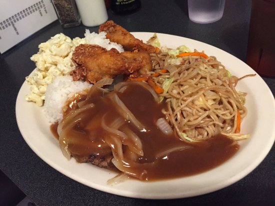 Tip Top : burger covered in gravy, chicken wings, rice, low mein and mac salad
