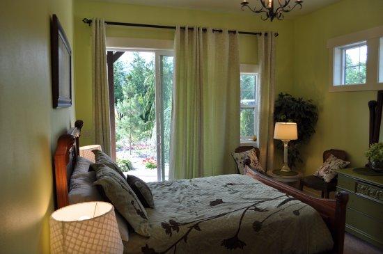 Manson, WA: Garden room opens to a garden patio.