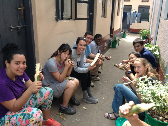 Kisoro, Uganda: Enjoying sugarcane in the courtyard