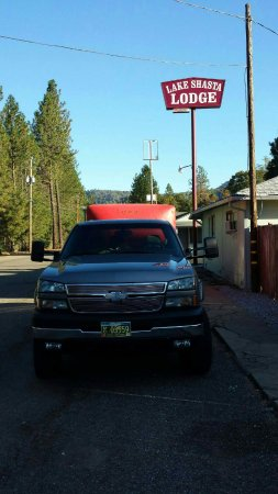 Lakehead, CA: My truck and trailer parked in front of Lodge with a flat on trailer. Pleanty of room to park .