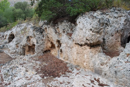 Cuevas de l'Alzinaret: a view of the tombs in relation to the landscape