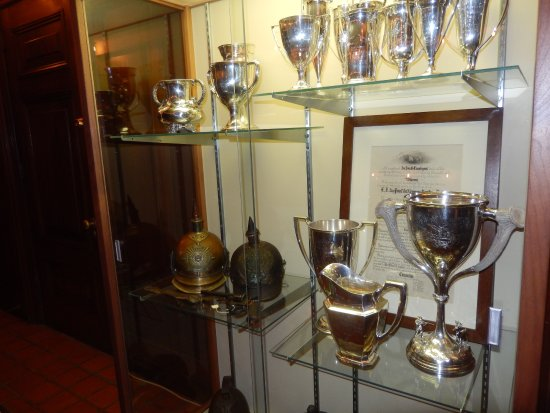 Wilmington, DE: trophy cabinet with loving cup (lower shelf, right) presented by workers when he left the compan