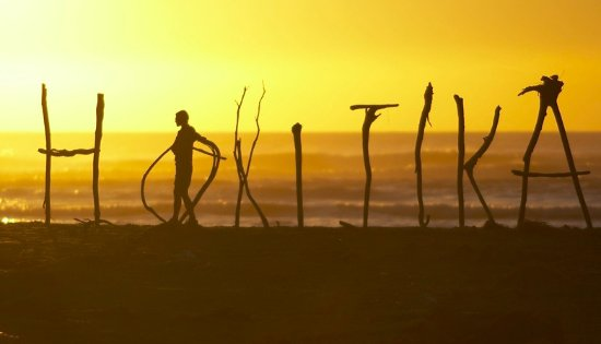 The Hokitika beach is a great place to watch the sun set and features the driftwood sign.