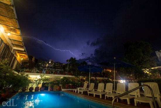 Hotel Posada de Roger: Lighting storm taken from pool on the second floor