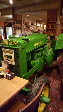 Cousins' Restaurant & Saloon: tractor in the dining room across from our table.