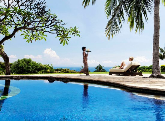 The Damai: Relax with view of the North Bali coast, all the way to the volcanoes of Java