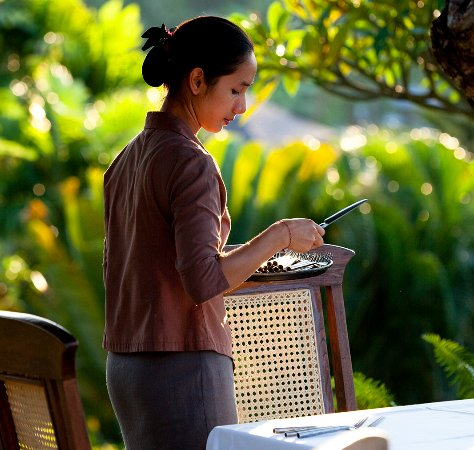 The Damai: Setting tables for dinner