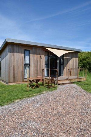 Braunton, UK: Cedar clad with zinc roofs luxury lodges.