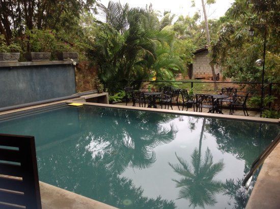 Pool right off of the open air breakfast dining area