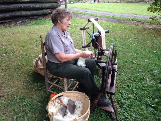 Meadows of Dan, VA: Park interpreter spinning thread from sheep wool