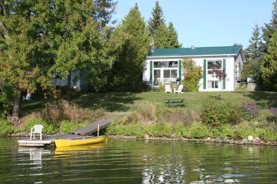 Elmhirst's Resort: A cottage and dock from the water