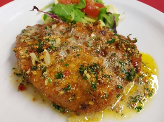 St Ives, UK: Cotoletta alla Milanese - Chicken breast in breadcrumbs topped with crispy garlic & chilli butte