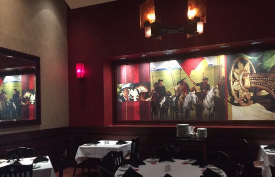 Fogo de Chao Brazilian Steakhouse: A view at those great Mural painting...proudly showing their Gaucho's origins !
