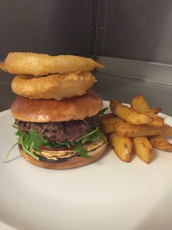 White horse lamb burger with John smiths beer battered onion rings and proper chips
