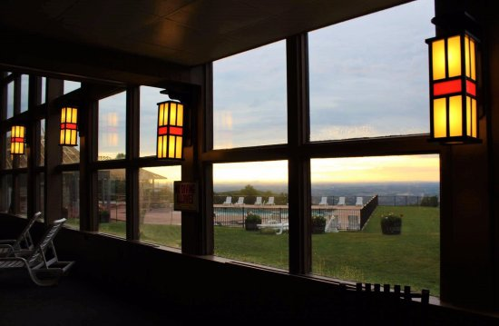 Historic Summit Inn : Evening lights in the indoor pool room, with stunning view behind it.