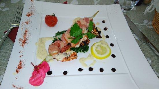 Sulniac, Frankrike: crevettes entourés d'une fine tranche de lard
