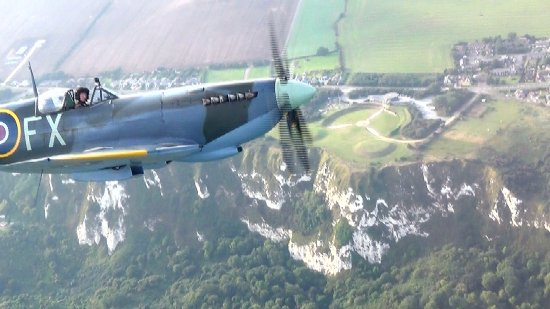 Headcorn, UK: Flying over the Battle of Britain Memorial at Capel-le-Ferne with the Spitfire