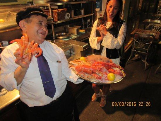 Outside o Le Petit Zinc: This man arranges the sea food platters