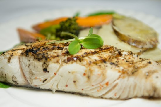 THE CABLE ROOM at the TELEGRAPH HOUSE: Grilled Halibut for true seafood connoisseurs, spiced with local ginger and hot pepper rub