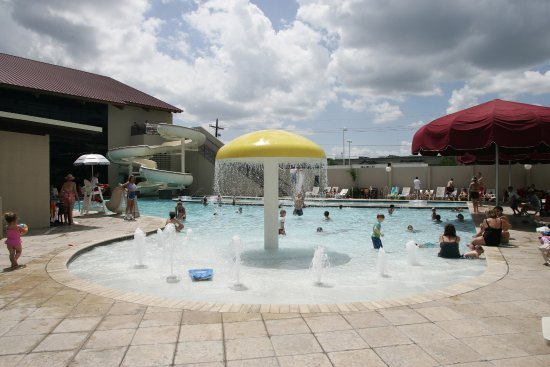 Lafayette, LA: Children's pool area including a zero entry, lazy river and water slide.