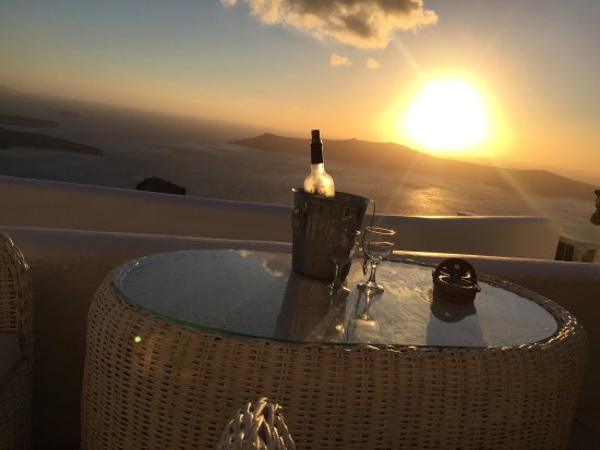 Iliovasilema Suites: White wine and sunset from my terrace