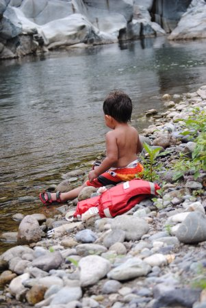 Jungle River Lodge: little D enjoying the river