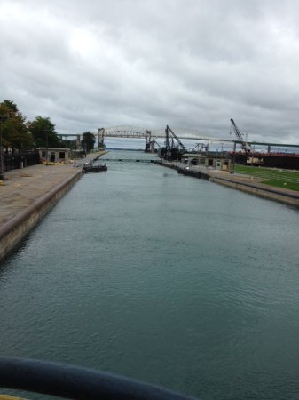 Sault Ste. Marie, MI: Gates are opening and boat tour passes through.