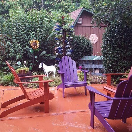 Side patio at Cedar House Inn & Yurts. So many cozy and cheerful places to visit!