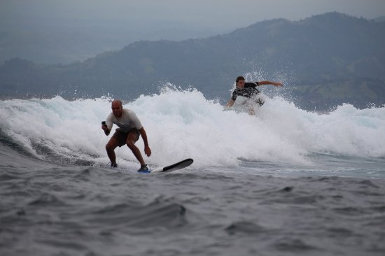Nusa Islands Surf School My Brother Steve On A Wave With His Son Kane