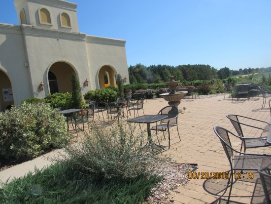 Kewaunee, WI: Front of the building with tables and vineyard in the bacground.