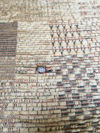Dymchurch, UK: Burn mark on sofa.