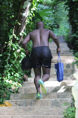 Tropical Lagoon Resort: BF Running up the steps from the beach (Blue Lagoon)