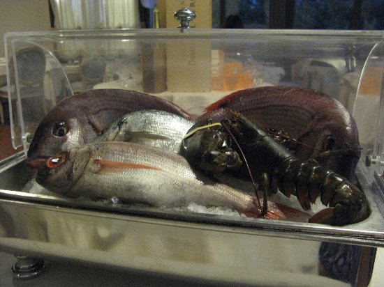 Fresh seafood trolley presented at table at Hotel San Giorgio restaurant