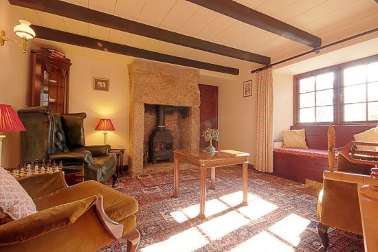 Sithney, UK: The Guest lounge with log burner in feature fireplace