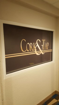 Microtel Inn & Suites by Wyndham Brooksville: Sign to right of doorway of Cork & Tap