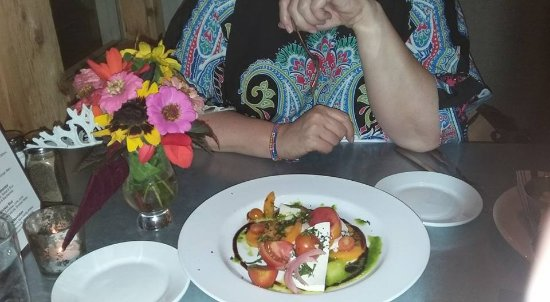Baileys Harbor, WI: Caprese (Tomato) salad and flowers they picked for my wife's birthday!