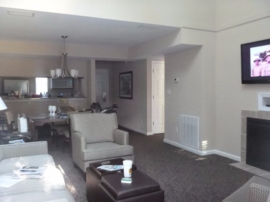 The Historic Powhatan Resort Living Room With Fireplace Flat Screen Tv Kitchen At