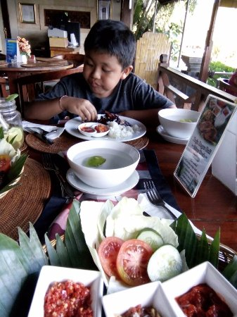 Subagan, Indonesia: Our son enjoying his chicken wings