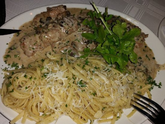 Kloof, Güney Afrika: Veal Marsala with a side of pasta and freshly grated Parmesan cheese.