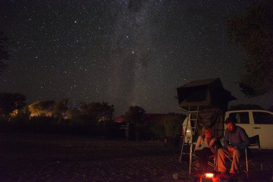 Fish River Canyon, Namibia: Camping out with a fire under the stars.
