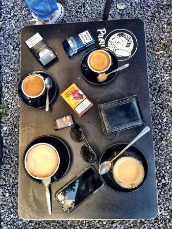 Godshot: coffee outside on the improvised chairs and coffee tables on the coblestone