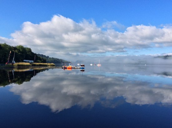 Gwynedd, UK: A morning view of Bala Lake with Jetty Cafe and the Sailing Club on the left shore.