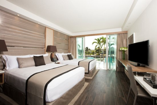 Bimini: Enjoy all the essential amenities in a luxury guest room, offering 2 queen beds and modern bathr