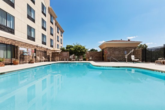 Selma, TX: Relax by our outdoor Swimming Pool