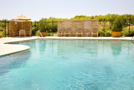 Selma, TX: Take a cool swim or just relax by the side of the pool