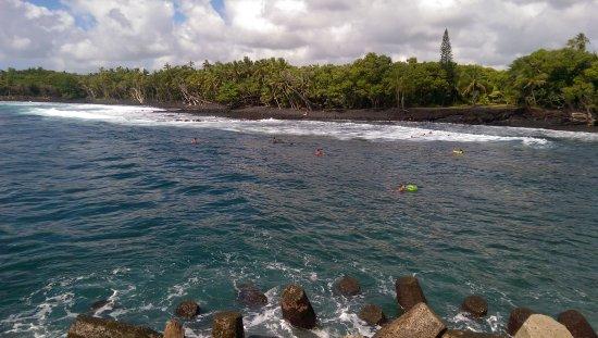 Pahoa, HI: Surfers at Issac Hale Park