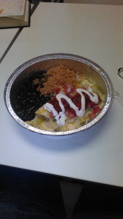 Cardston, Canada : The Enchilada Verde with rice and beans.  Note that the toppings are what I chose.  Yours may be