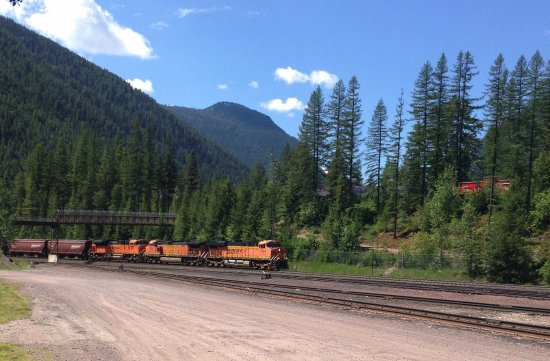 Essex, MT: BNSF passing by hotel. Note Red Caboose room in trees
